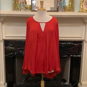 Jennifer Lopez red angel sleeve keyhole top